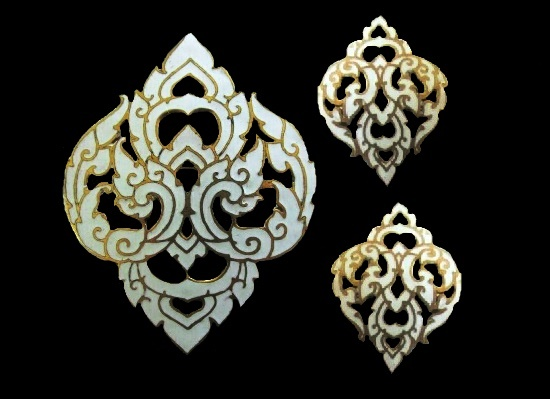 Gold tone white enamel brooch and earrings