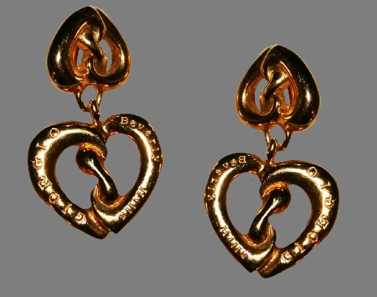 Heart shaped dangling earrings, engraved Giorgio Beverly Hills on the front side. Gold tone metal
