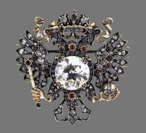 Heraldic brooch in the form of the coat of arms of the Russian Empire. Gold, platinum, diamonds, rubies, diamonds. Moscow, 1913