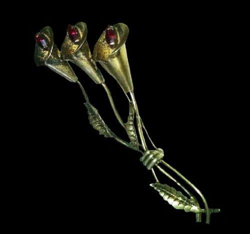 Lily brooch. Gold tone metal, faux ruby rhinestones