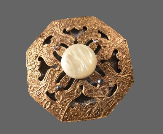 Octogon shaped brooch. Gold tone textured metal, mother-of-pearl, rhinestones