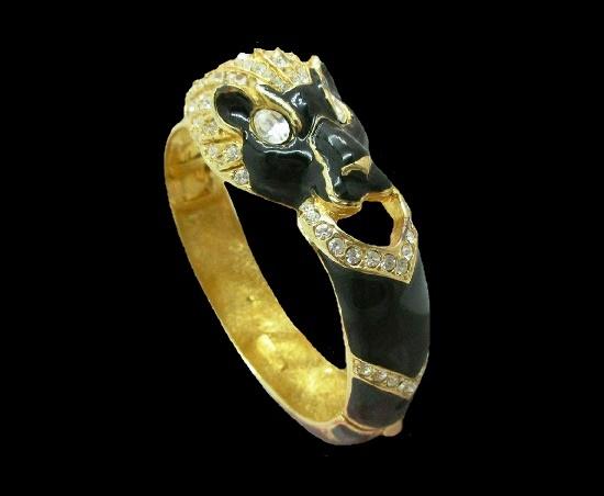 Panther's head bracelet. Gold tone metal, black enamel, clear crystals