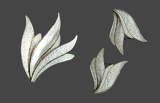 Plant motif brooch and earrings. Sterling silver, textured, white enamel