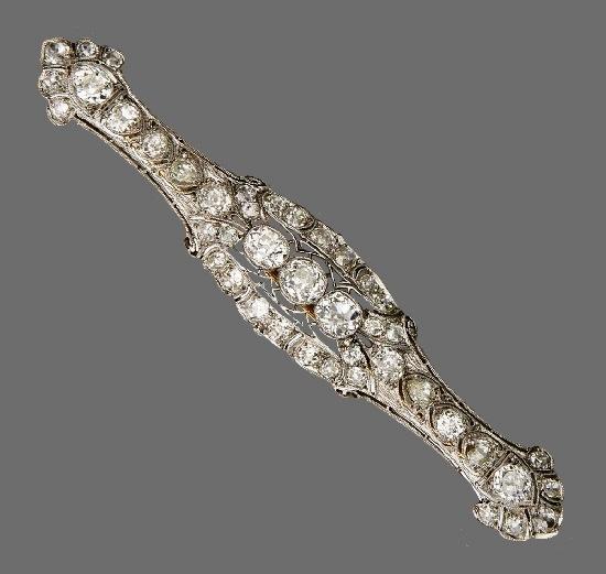 Platinum and diamond bar brooch. 1900s