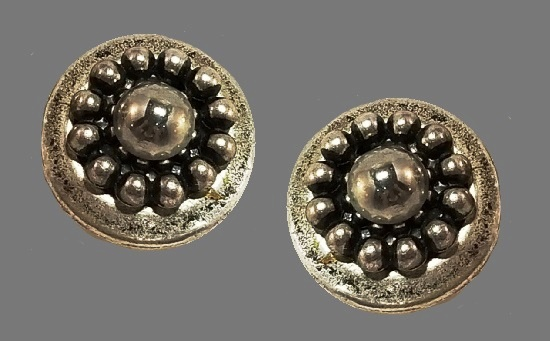 Round shaped clip on earrings. Silver and black beads, resin, glass