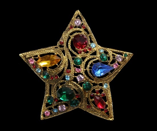 Star brooch. Gold tone alloy, gold filled, art glass. 6.5 cm. 1950s
