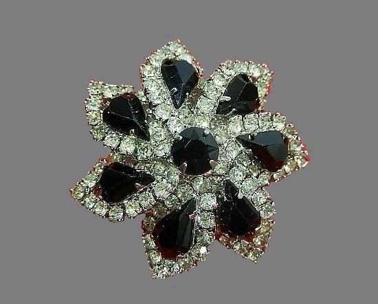 Star flower brooch. Clear and black rhinestones
