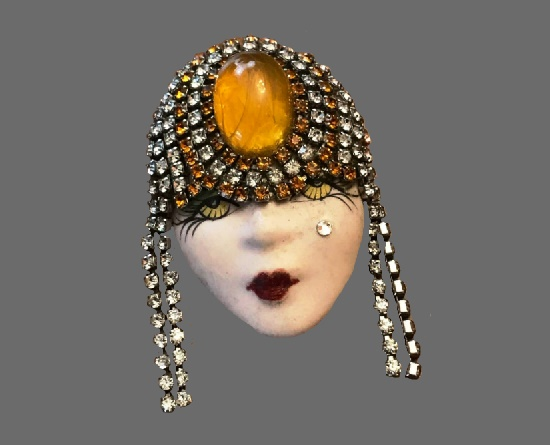 The third eye brooch. Porcelain, crystals yellow art glass