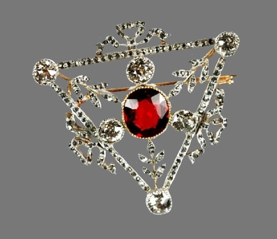 Triangle shaped brooch. Gold, diamonds, ruby