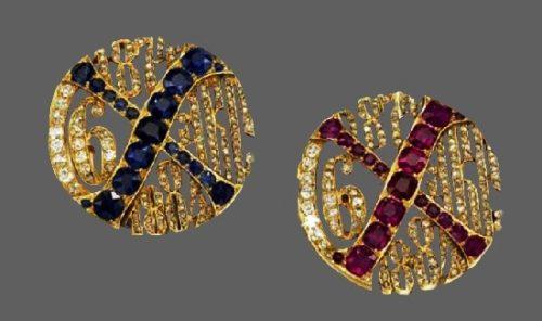 Two cufflinks. Gold, rubies, sapphires