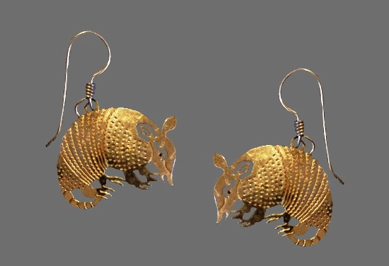 Armadillo dangle earrings. Gold plated textured metal