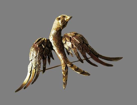 Bird brooch of gold tone