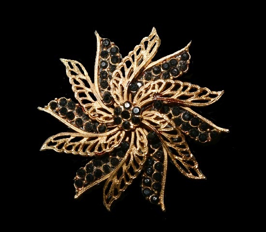 Black rhinestone gold tone flower brooch. 1960s. PIM