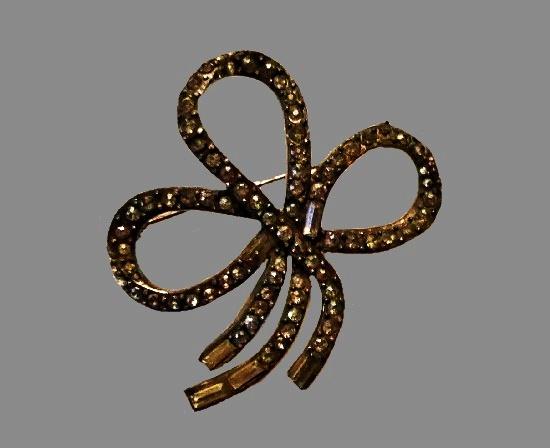 Bow brooch. Silver tone metal, rhinestones