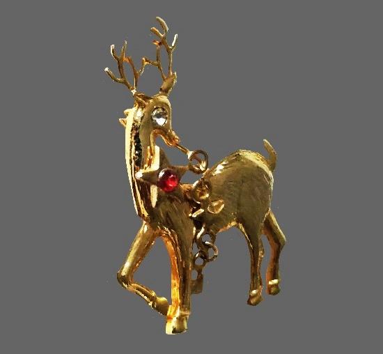 Christmas reindeer brooch. Gold tone, rhinestones