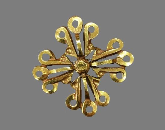 Cross brooch of gold tone