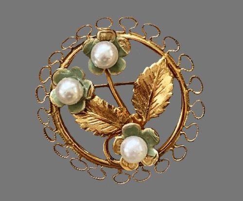 Filigree framed flower brooch. Gold tone, faux pearls