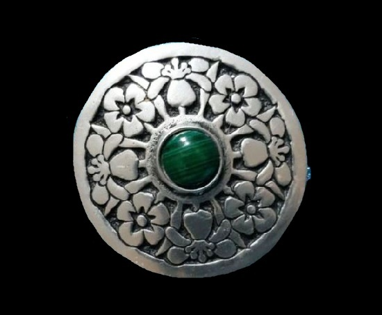 Floral design round shaped brooch with green stone in the center