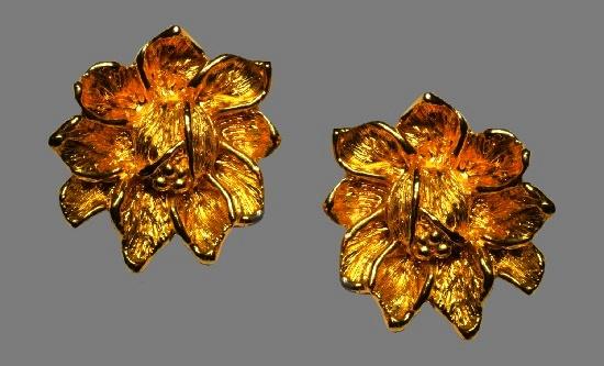 Flower gold tone clip on earrings