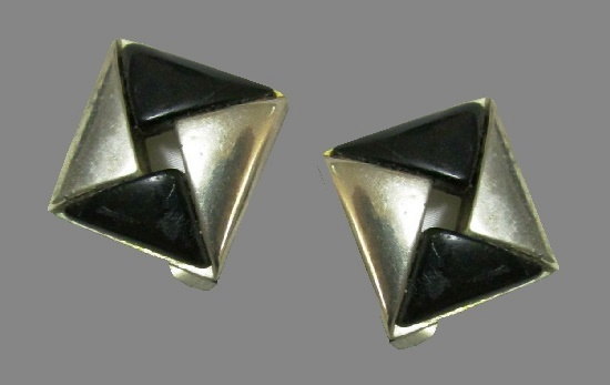 Geometric design clip on earrings. Silver tone metal, black plastic. 1980s