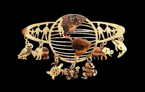 Globe of Animals dangle brooch. 14 karat gold-plated