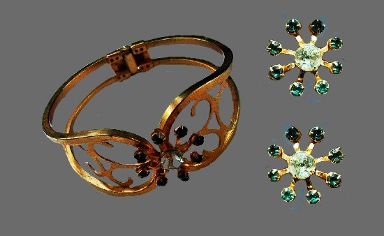 Gold tone floral design bracelet and screw back earrings with blue rhinestone