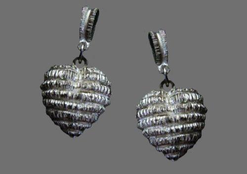 Heart shaped silver tone textured metal earrings