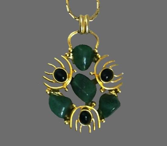 Jade and onyx gold tone pendant