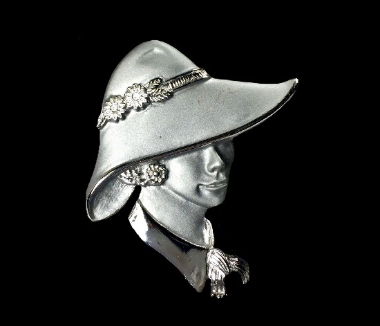 Lady in hat brooch. Silver tone metal