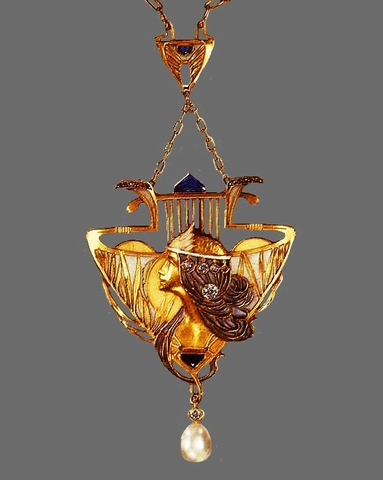 Maiden pendant. 18 Karat Gold, enamel, natural pearl, rose-cut diamonds, ruby. Circa 1900