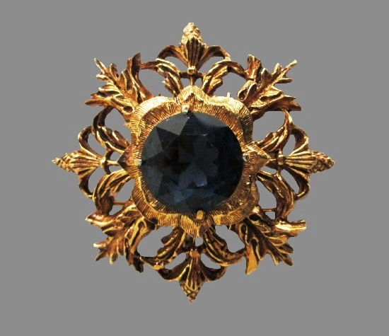 Maltese cross brooch pendant. Gold tone textured metal, blue glass cabochon