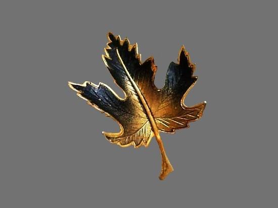 Maple leaf brooch. Gold tone textured metal, enamel