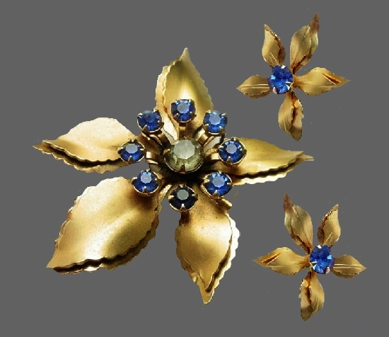 Matte gold tone flower brooch and earrings with blue rhinestones