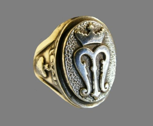 Monogram adjustable ring. Silver and gold tone metal
