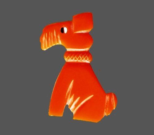 Orange bakelite dog brooch pin