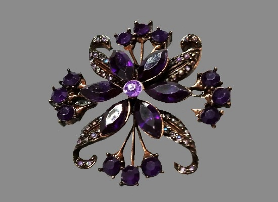 Purple flower brooch. Silver tone metal, rhinestones