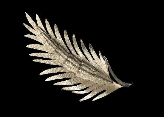 Silver tone textured leaf brooch. 1960s