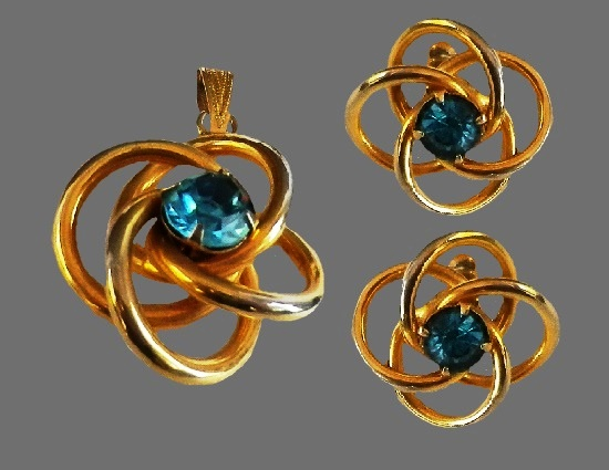 Twisted rings design pendant and earrings. Gold plated, rhinestones