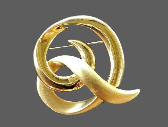 Swirl gold tone brooch