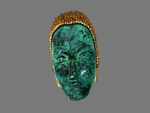 Tribal face enameled brooch