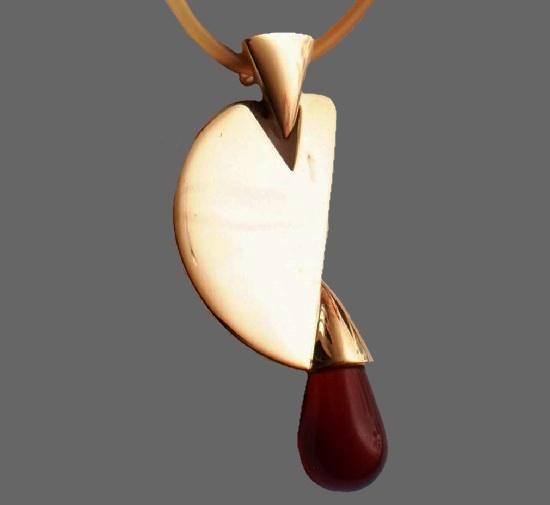Abstract design pendant. Gold tone, rhodium plated, lucite. 1990s. 7 cm