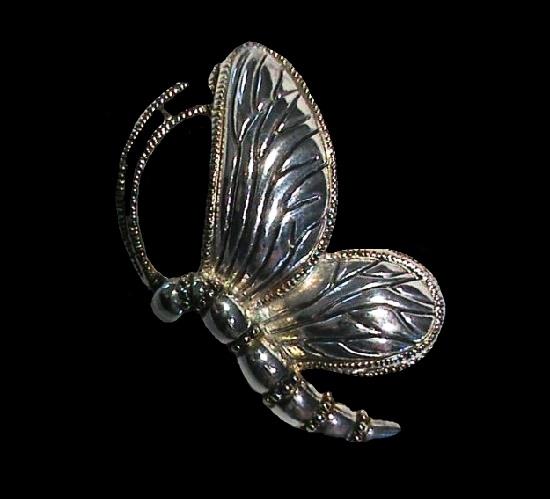Butterfly brooch of silver tone