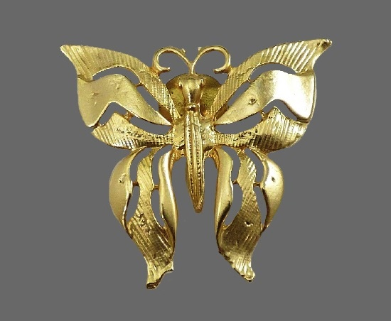 Butterfly lapel pin. Gold tone textured metal