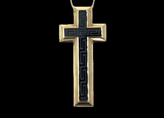 Cross pendant. 18 K gold, black onyx with carved greek patterns