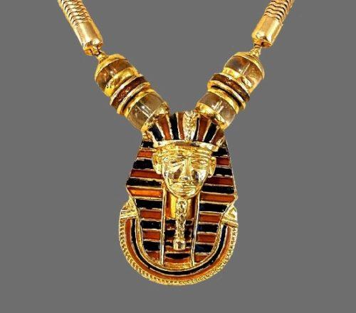 Egyptian revival pendant necklace. Gold tone metal alloy, enamel, art glass