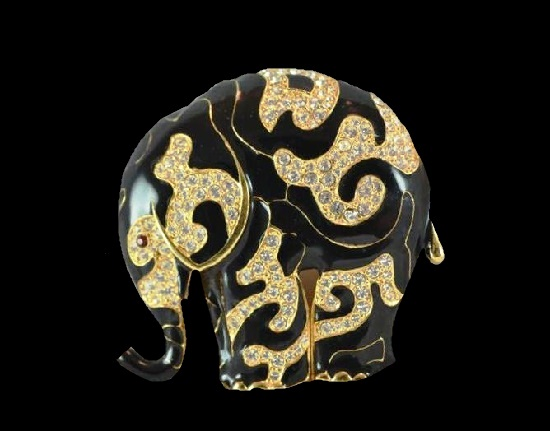 Elephant brooch. Gold tone metal alloy, black enamel, rhinestones. 1990s