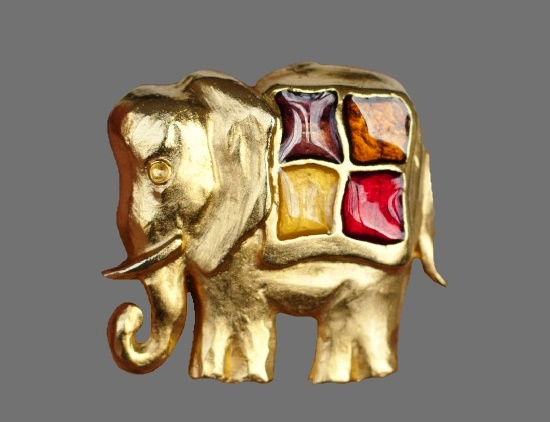 Elephant vintage brooch. Gold tone metal, enamel. 4.5 cm. Marked with Lancome rose sign