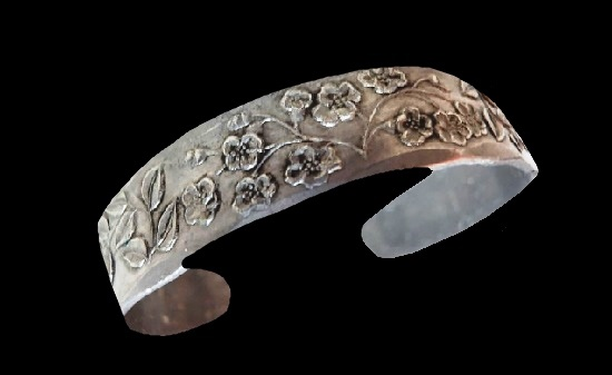 Floral design textured hand wrought pewter cuff bracelet. Before 1950