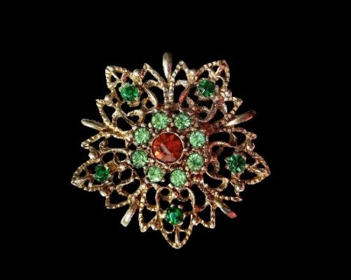 Gorgeous star flower brooch of gold tone, rhinestones. 5 cm. 1960s