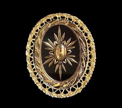 Oval shaped framed star brooch pendant of gold tone